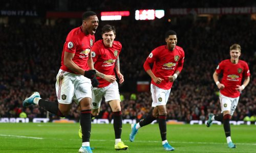 MANCHESTER, ENGLAND - JANUARY 11: Anthony Martial of Manchester United celebrates after scoring his team's third goal during the Premier League match between Manchester United and Norwich City at Old Trafford on January 11, 2020 in Manchester, United Kingdom. (Photo by Catherine Ivill/Getty Images)