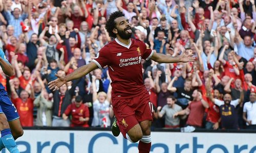 LIVERPOOL, ENGLAND - AUGUST 27: (THE SUN OUT, THE SUN ON SUNDAY OUT) Mohamed Salah of Liverpool celebrates after scoring during the Premier League match between Liverpool and Arsenal at Anfield on August 27, 2017 in Liverpool, England. (Photo by John Powell/Liverpool FC via Getty Images)